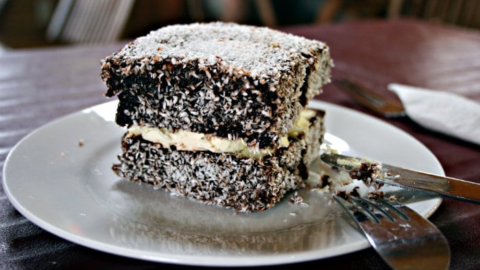 Lamington is made with sponge cake and sprinkled with coconut.