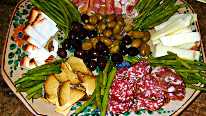 Salami, cheese, olives are popular antipasti ingredients.