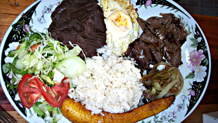 Casado always includes rice, beans, fried plantain.