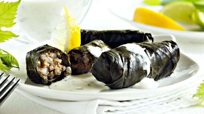 Dolmades are made with ground meat stuffed in grape leaves.