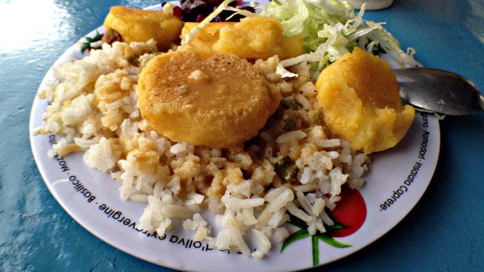Llapingachos are made with mashed potatoes, onions and cheese.