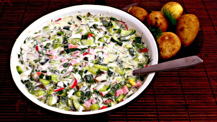 Okroshka is made with fresh vegetables and hard boiled eggs.