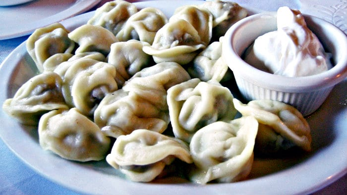 Pelmeni can be eaten with a choice of sour cream, butter, vinegar or mustard.