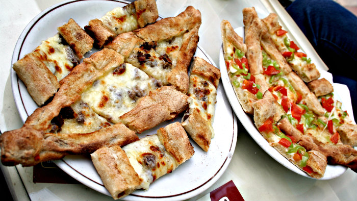 Pide is easy to eat on the run because of its shape.