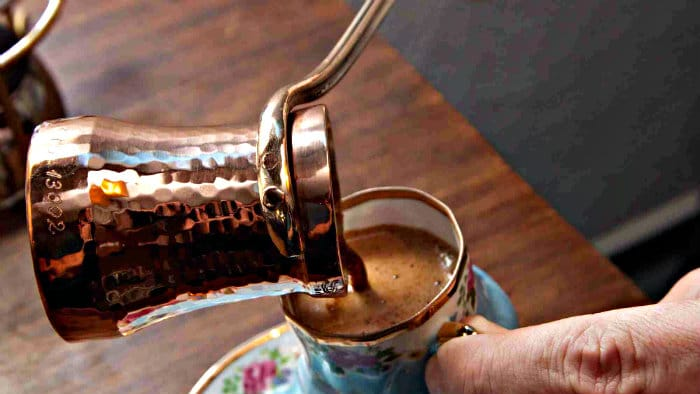 Turkish coffee is made in a small copper pot with a long handle.