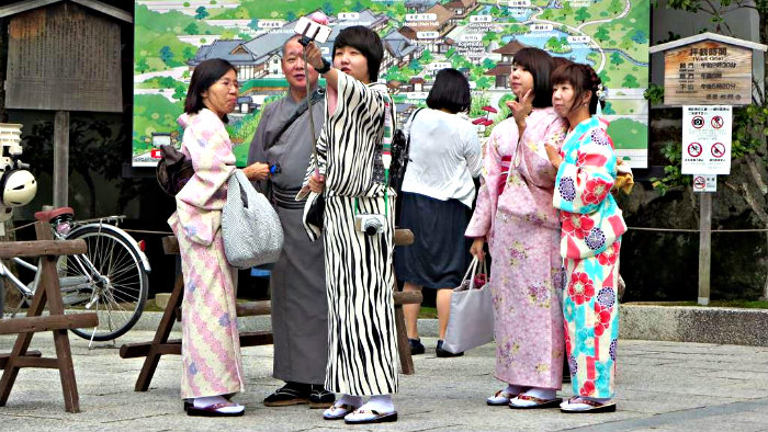 Taking a selfie in traditional Japanese costumes.